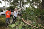 LR - Diane Philbin and Miami Dolphins Special Teams Members at Rebuilding Together Project in Hollywood